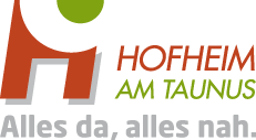Neue Bücher und Hörbücher in den Regalen der Stadtbücherei Hofheim